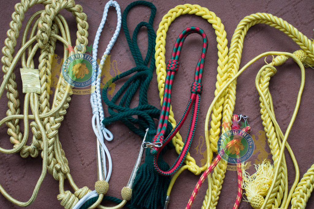 Lanyard Sword Knot Aiguillettes Braid Rope Ribbon Accessories Military Uniform Accouterments Lace Trimming Braid Gold White Silver Blue Weave Weaving Uniforms Accouterments Tailor Belts Leather Ceremonial Combat Cadet Parade Belts #Hand Embroidery #BullionEmbroidery #TradeBadges #MessDress #Badges #Ranks #Regiment #Parade #Ceremonial #Cord #Textile #ArmedForces #BritishArmy #Army #Aiguillette #Military #MilitaryUniforms #Militaria #Insignia #Headwear #Caps #OfficerCaps #UniformCaps #PeakCaps #DressCaps #MilitaryCaps #RailCap #Berets #Glengarry #RoyalNavy #RoyalMarine #RoyalAirForce #RAF #Infantry #Armor #EME #Battalion #Medals #Ribbons #Braid #Lace #Uniforms #UniformSupplie #Police #Security #Buckles #Guards #Accoutrement #Badge #Patch #Machine #MachineEmbroidery #HandEmbroidery #Bullion #BullionBadges #BullionEmbroidery #WovenBadges #Woven # Emblems #Regiment #Regimental #OfficerCaps #PeakCaps #Soldier #Helmets #Covers #HelmetCovers #Armlets #Sliders #Epaulettes #Webbing #Chevron #Officer #ShoulderBoards #Gorgets #Tassel #Sash #Hand #HandSewn #Aviation #AviationClothing #Crest #FamilyCrest #CoatofArms #EmbroideredPillows #Cords #Aiguillettes #CapCords #ChinCord #DressCord #SwordKnot #Tassels #WhistleCord #Lanyard #Knots #Banners #ClanBadges #Peaks #Visor #Wings #CapBadges #Pennants #HonorCaps #OfficerCaps #SportsCap #Masonic #Aprons #MasonicAprons #Collars #MasonicCollars #Gloves #MasonicGloves #MasonicPatches #Patches #Regalia #MasonicRegalia #Freemason #Braid #Chevron #Cuffs #Fringes #Sashes #HeadGear #FieldGear #England #USA #Poland #ArmedForces #Schools #Colleges #University #Sialkot #Pakistan Sialkot Pakistan PeakCaps OfficerCaps ShoulderRanks BullionBadges UniformAccessories MilitaryUniforms DressCap TradeBadge RankMarking WireBadges Army Airforce Navy Police